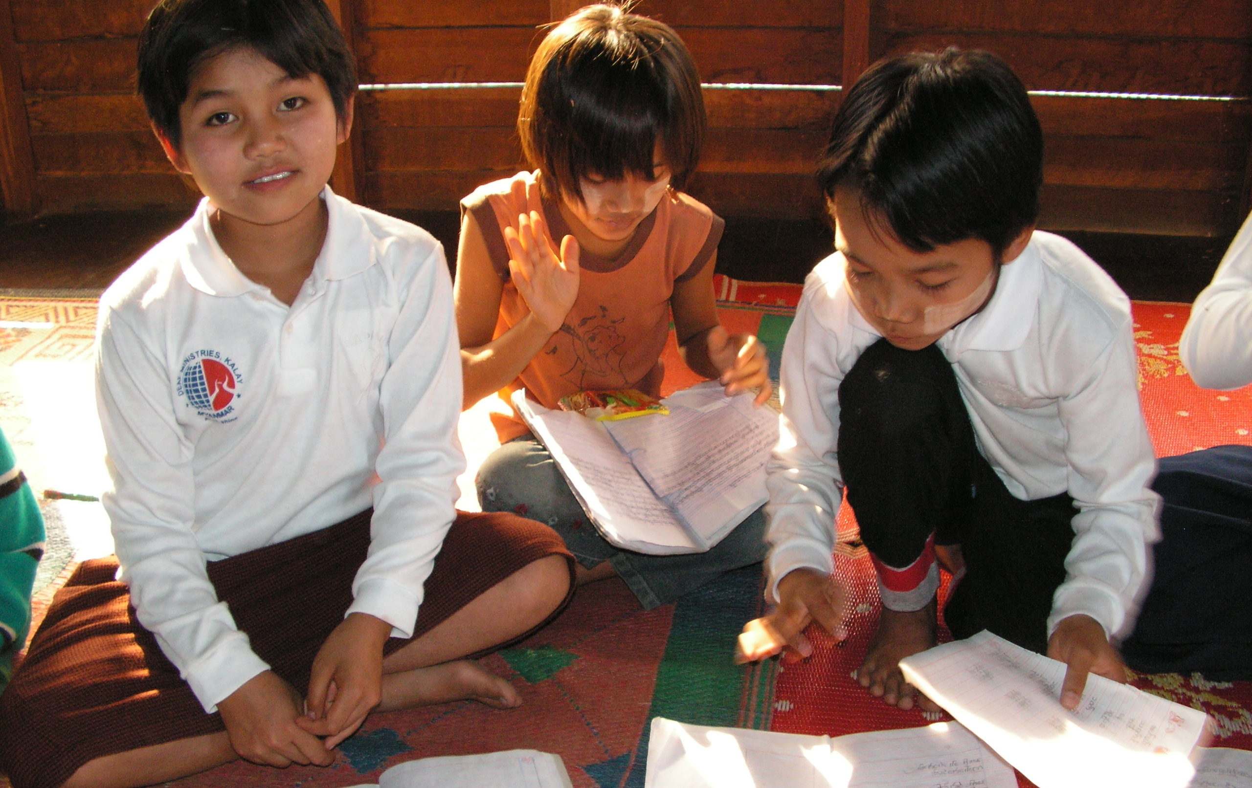 Three Kalay students on floor